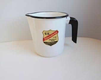 Vintage small black and white enamel pitcher