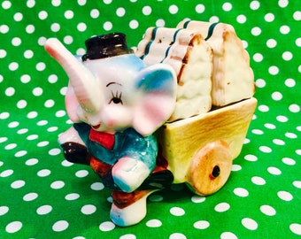 Anthropomorphic Elephant Boy pulling a Cart Salt and Pepper Shakers from Japan circa 1950s