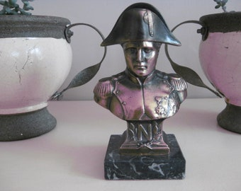 Bust of Napoleon Bonaparte in bronze on a marble pedestal.