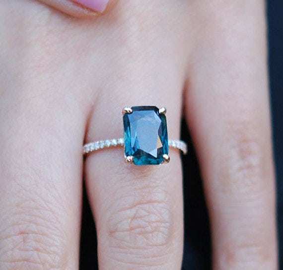 Peacock sapphire engagement ring.