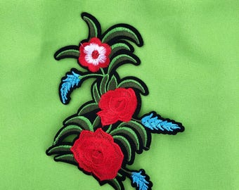 Embroider multicolor flower iron on.