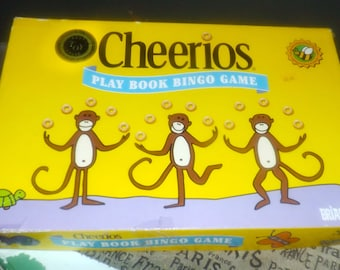 Vintage (1997) first-issue Cheerios Play Book Bingo board game.  Toddler bingo image and color matching. Published by Briarpatch. Complete.