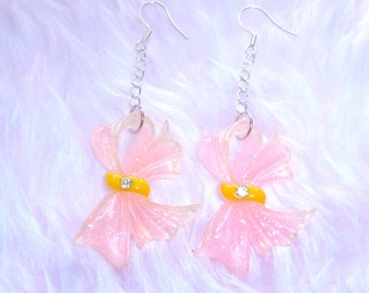 All Wrapped Up - Pink Sparkly Bow Earrings On Sale