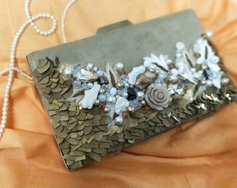Evening velvet clutch with hand crafted work.