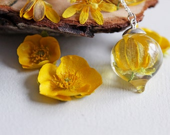Pendant drop of resin and faux Ranunculus