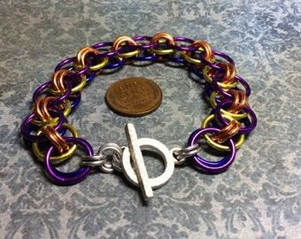 chainmaille bracelet -Reversible yellow, orange and voilet on one side and orange, yellow and dark purple  on the other-