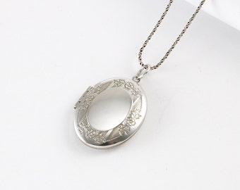 Sterling Oval Locket with Floral Border