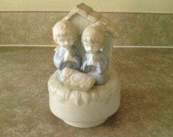 "Nativity Scene  Musical Figurine, ""Silent Night""."