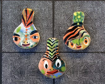 Three Face Shaped Refrigerator Magnets by Jenny Mendes