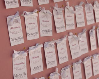 Escord cards table plan tags pinned to a large format frame