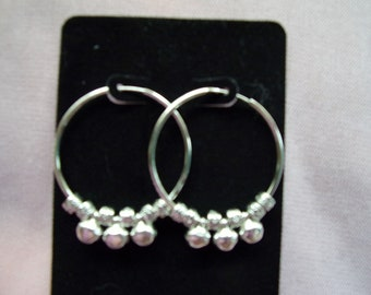 Beaded continuous stainless steel hoops