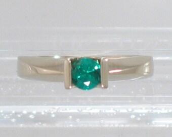 White Gold Saddle ring with 0.24 carat Round Emerald