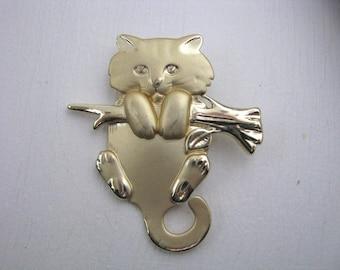 Gold tone kitty cat brooch pin on tree limb