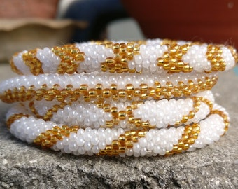 Golden and Ivory White Crocheted Seed Beads Bracelets Set from Nepal, Roll on Your Wrist, Crocheted