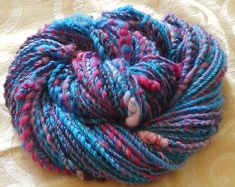 Bubblegum Crisis handspun merino art yarn with chunky knots, 72 yards