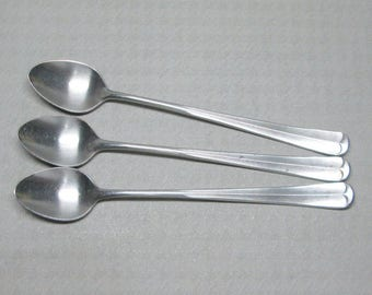 SCC stainless Colonial pattern three iced tea spoons