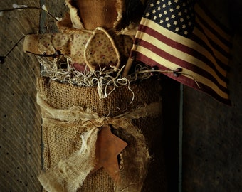 Primitive Grungy Americana Hanging Burlap Bag with Stump Doll and Flag