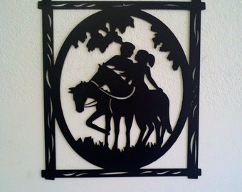 plasma cut metal wall hanging with lovers on horses
