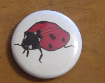 Lady bird pin badge
