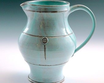 Turquoise large pitcher.