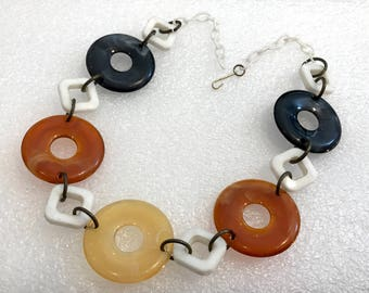 Vintage early plastic amber colors circles necklace