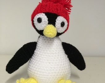 Cute crocheted penguin soft toy