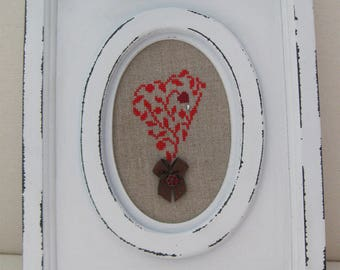 Oval white frame with embroidered heart