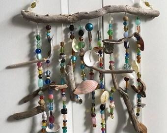 Handmade driftwood seashell and glass window hang