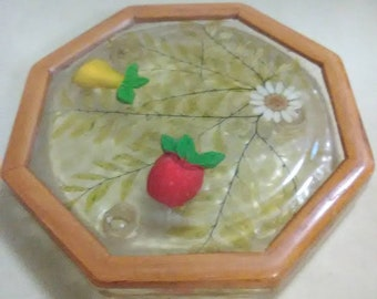 Vintage clear and wood trivet. Pear, apple and daisy design. Plastic and wood. Red, yellow and white.