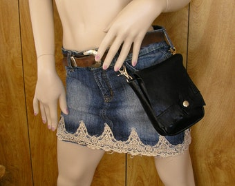 "Black leather Clip on Hip Bag, 5"" x 6"" x 2"" with a snap, one inside pocket and two trigger clips"