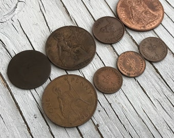 Small collection of 8 vintage UK copper coins; 3x one pence, 1921 and 1967, 1x very worn Victorian coin, 1x  Farthing 1945 and 3x half pence