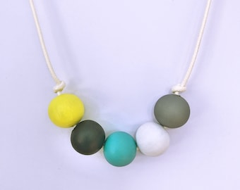 grey, white, blue, black and yellow hand painted wooden bead necklace
