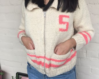 Pink and beige varsity 70s zip up cardigan sweater