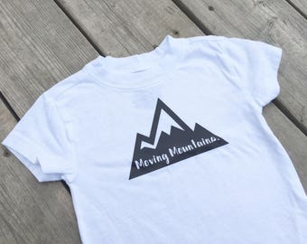 """Moving Mountains - Down Syndrome Awareness Shirts ~ Girls and Boys, White T-shirt with Black """"Moving Mountains"""" Logo"""