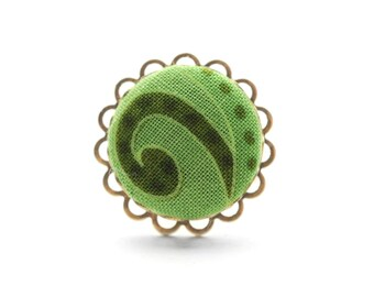 Sweet swirl, cute as a button: an adjustable ring adorned with a handmade fabric covered button