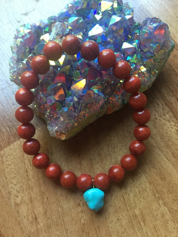 Base and Throat Chakra Stretch Bracelet of Red Coral with Turquoise Charm