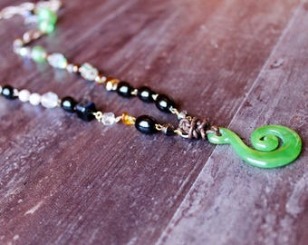 Naphatalia long beaded necklace has that Sundance style.