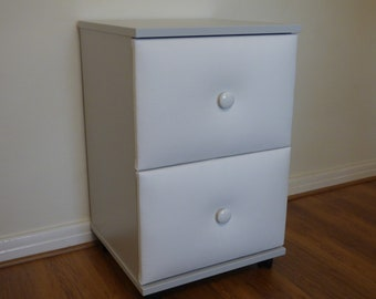 Nightstand/bed side cabinet with upholstered drawers