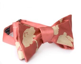 Poppy Printed Bow Tie. Floral Print Bowtie. Silkscreen design, warm cream print on dark salmon freestyle bow tie. Adjustable.