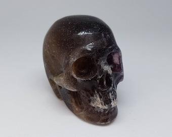 """2"""" dark fluorite crystal skull."""