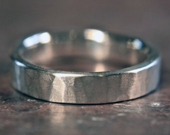 Recycled sterling silver 4mm wide wedding ring. Heavy planished finish. Hand made in the UK.