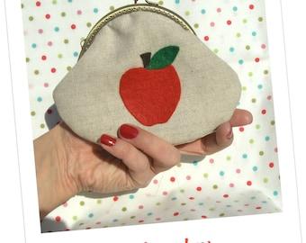Monedero con manzana