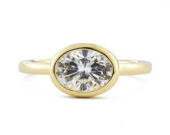 East West 1.5 Carat Moissanite Oval Engagement Ring, 14K Gold Bezel Moissanite Wedding Ring, Open Side Views, made to order in 3-4 weeks