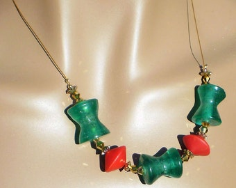 Contemporary necklace red disc green hourglass with gold