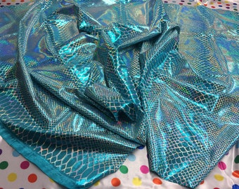 Turquoise Iridescent Dragon Scales on a Nylon 2 way stretch Spandex Sold by yard.