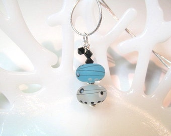 Necklace blue, white, black glass art lampwork bead and black crystals