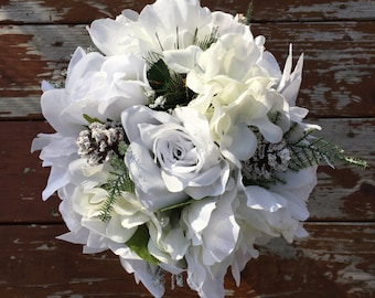 White Winter rose, peony and poinsettia Bridal Bouquet with matching boutonniere