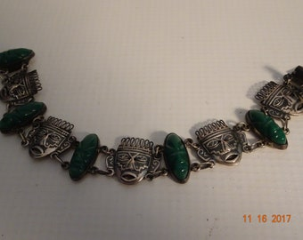 "Sterling Silver and Green Onyx Aztec Warriorhead Bracelet-size 7 1/4"" long by 3/4"" wide"