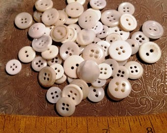 Mix of miscellaneous white, off white, opalescent shirt buttons