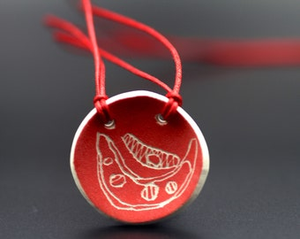 """Ceramic """"Gather & Share"""" pendant, hand painted red with string bean design. Red cotton cord necklace jewellery."""